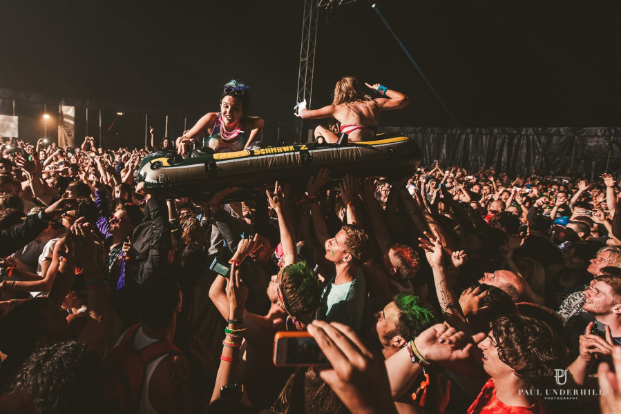 Crowd surfing at festival youth culture photography
