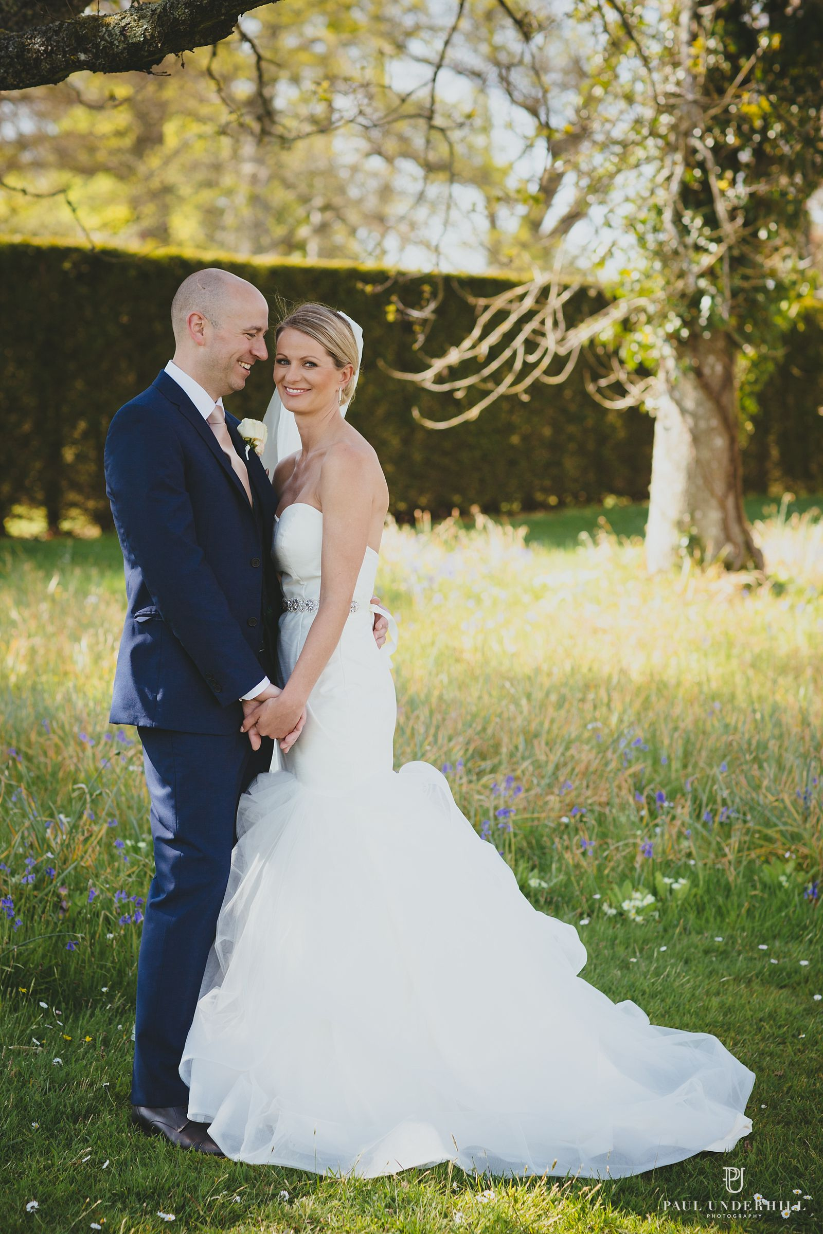 Bride and groom portrait at Lulworth castle