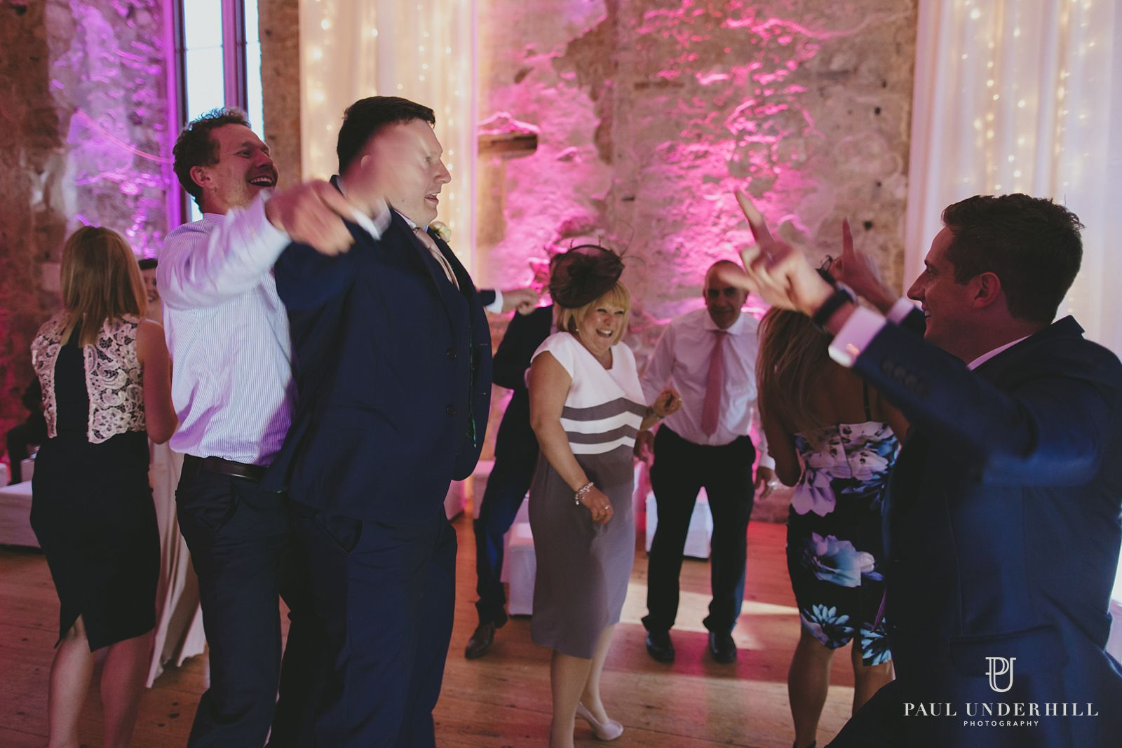 Guests having fun Dorset wedding