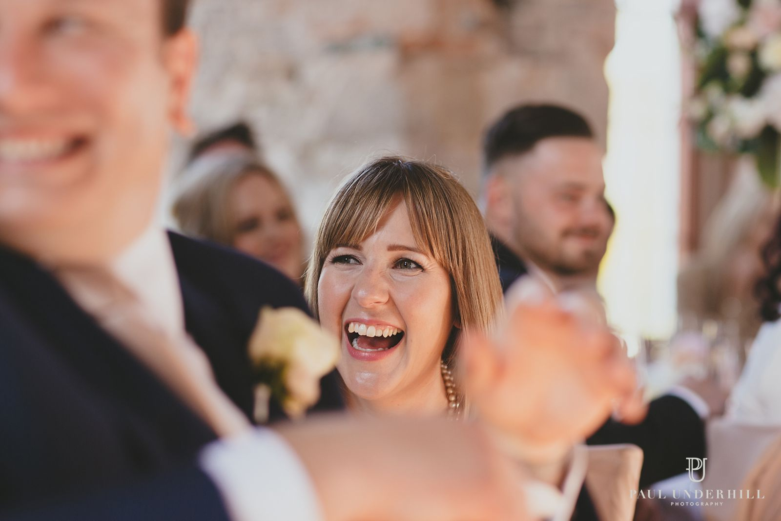 Guests laughing Lulworth wedding
