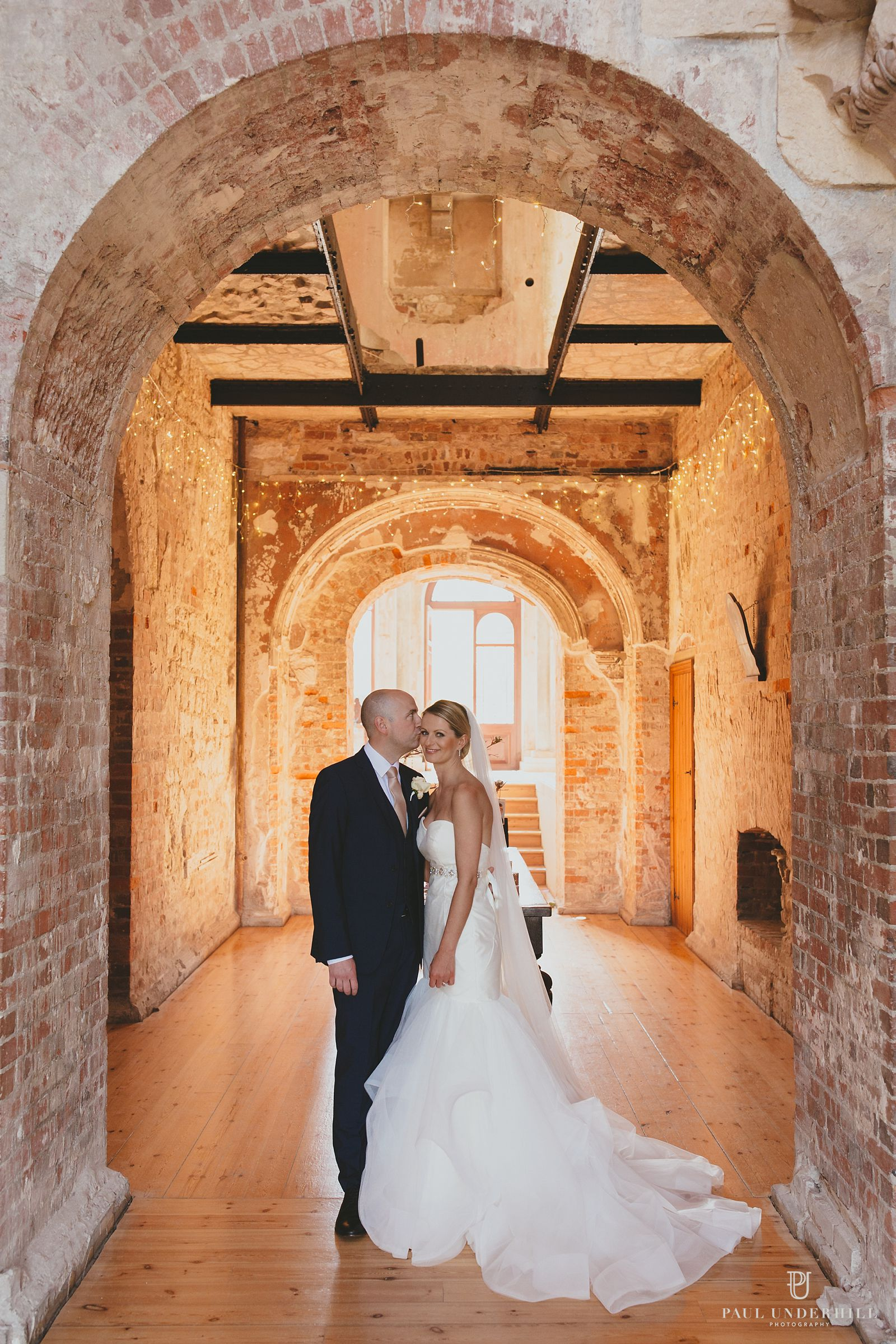 Wedding portrait inside Lulworth castle