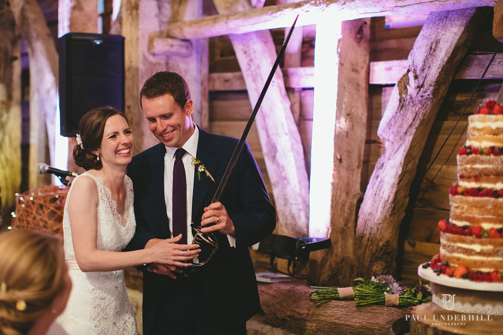 Cutting cake Stockbridge Farm Barn wedding