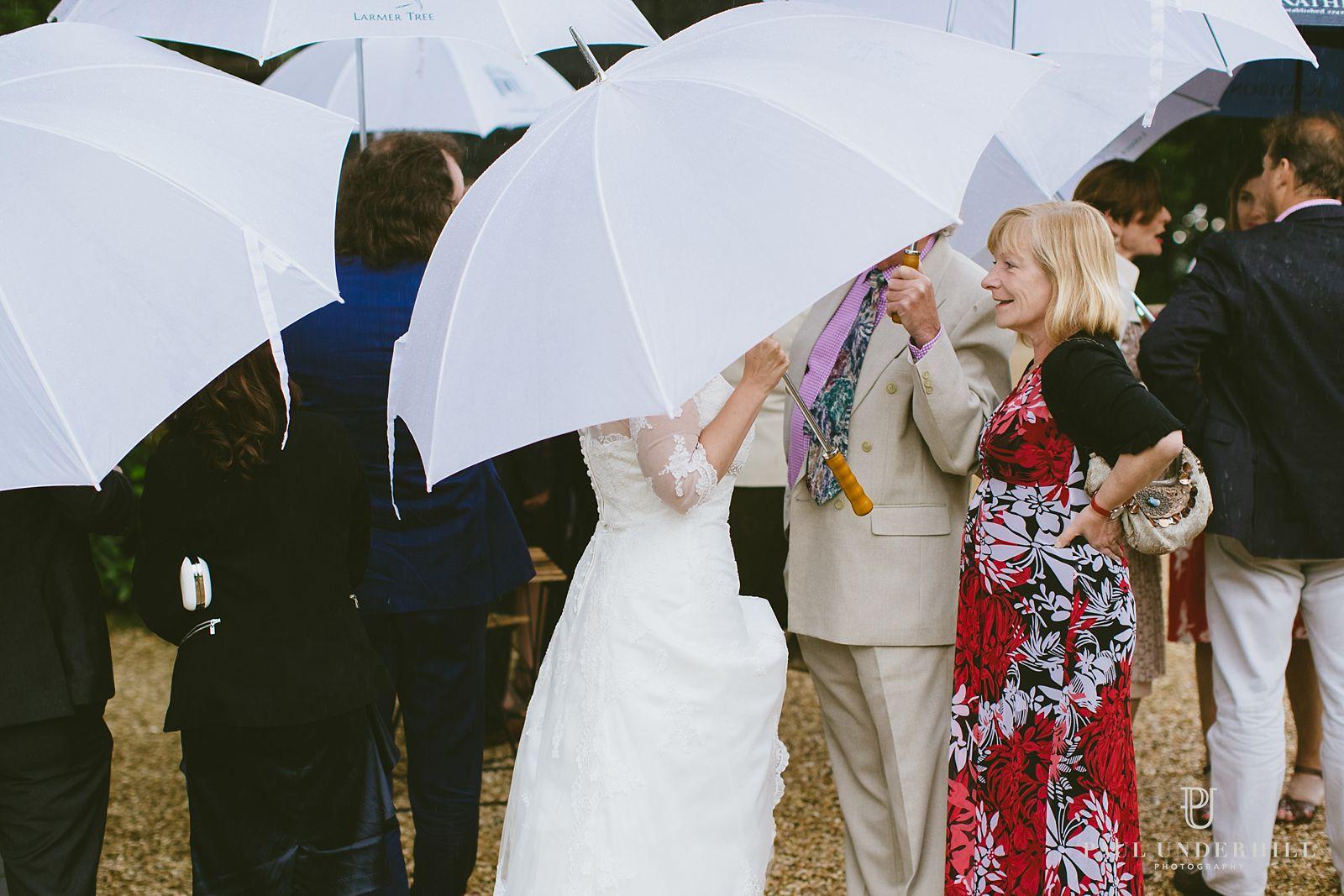 Bride under umbrella wedding documentary