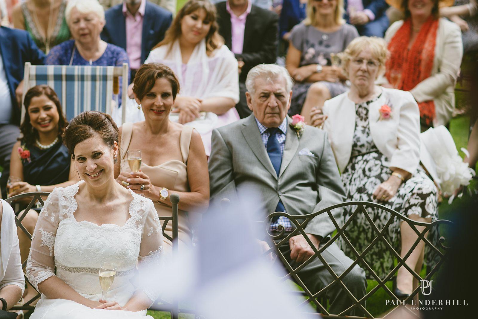 Bride watches groom speech wedding documentary
