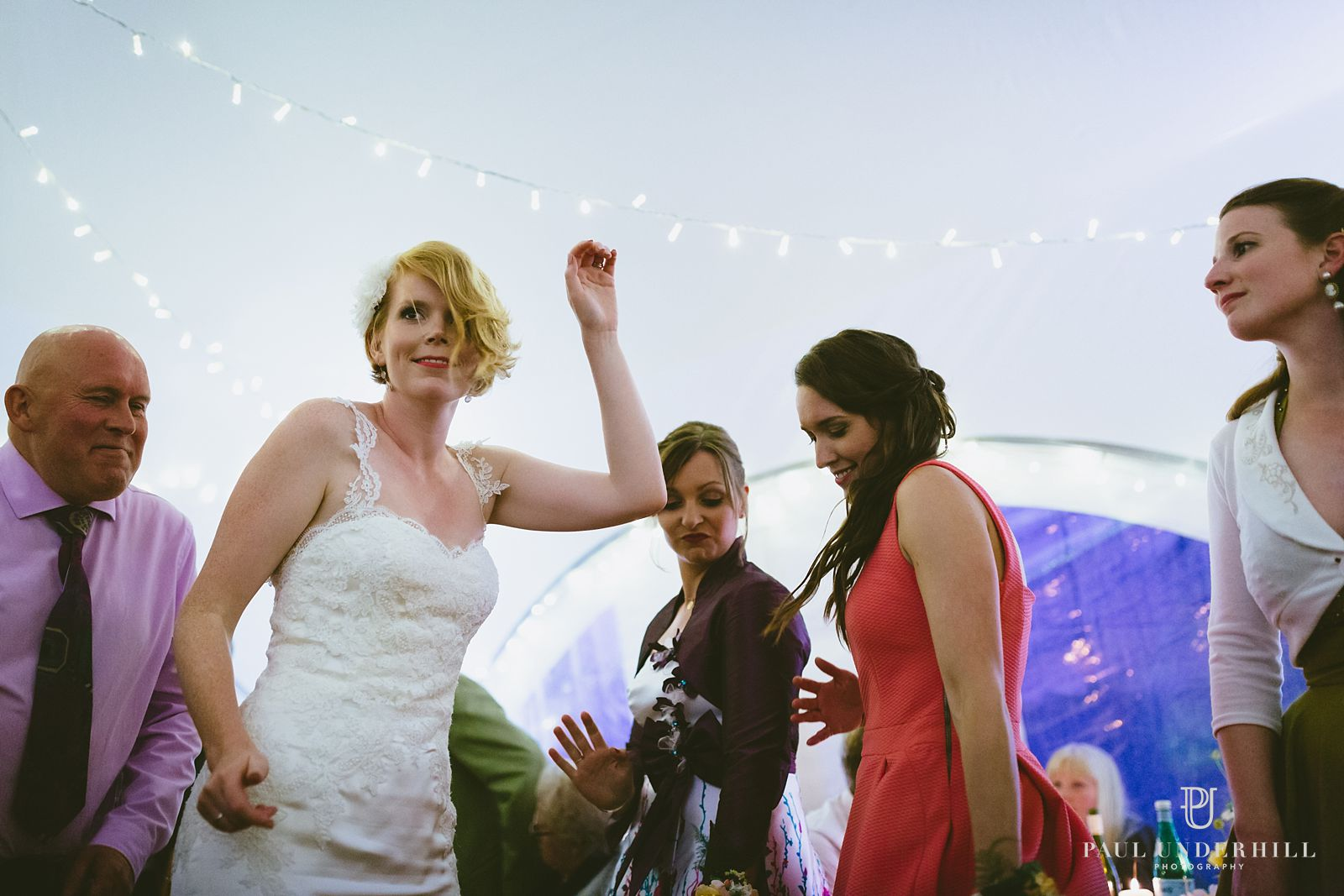 Candid photo of bride dancing