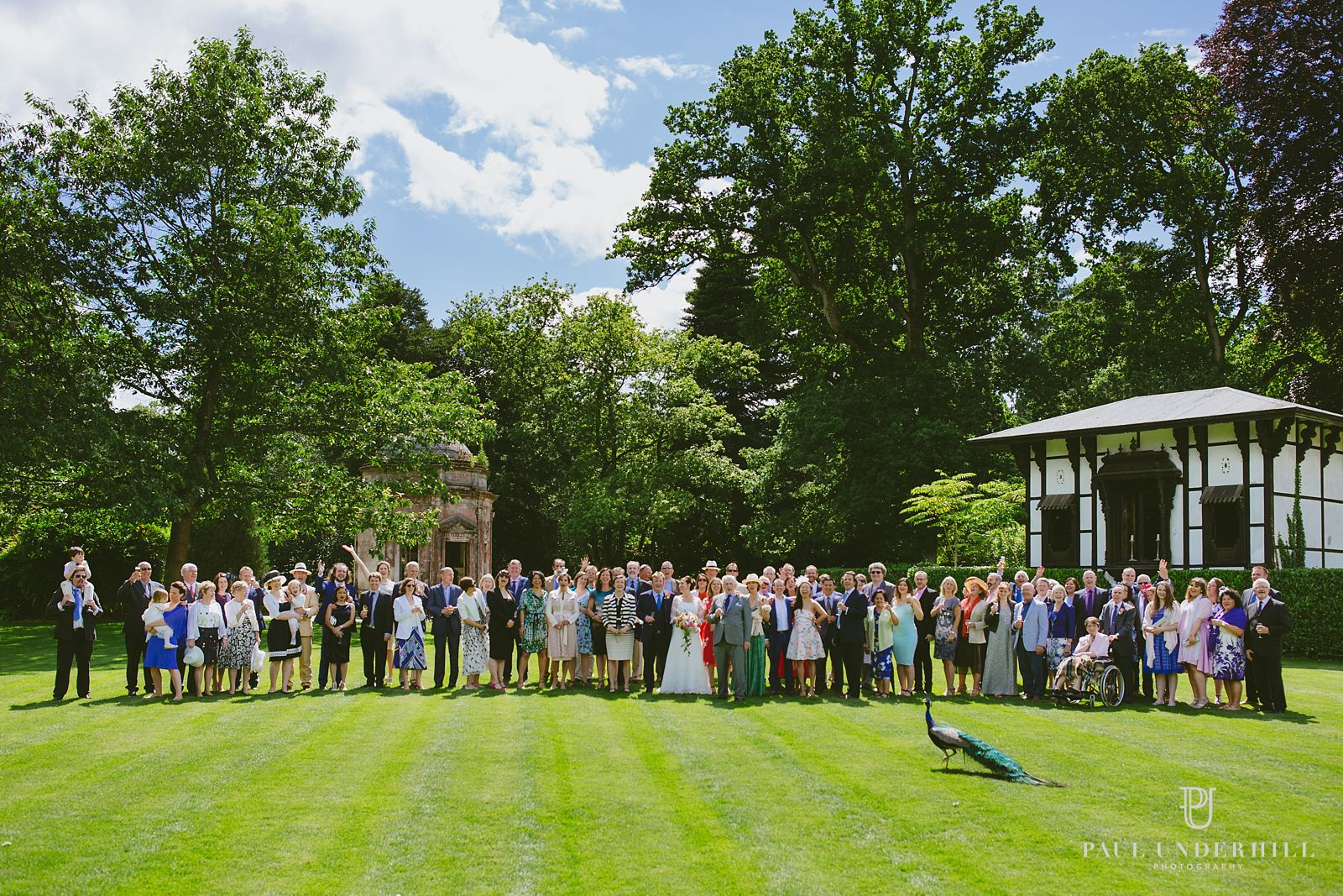 Group photo Larmer Tree wedding