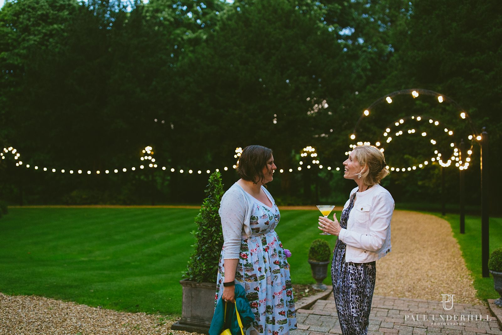 Guests outside Larmer Tree wedding