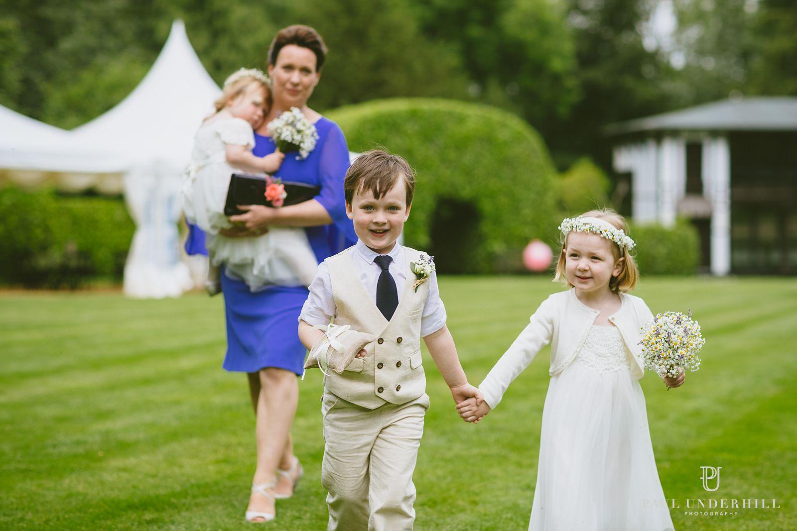 Page boy and flower girl Larmer Tree gardens wedding