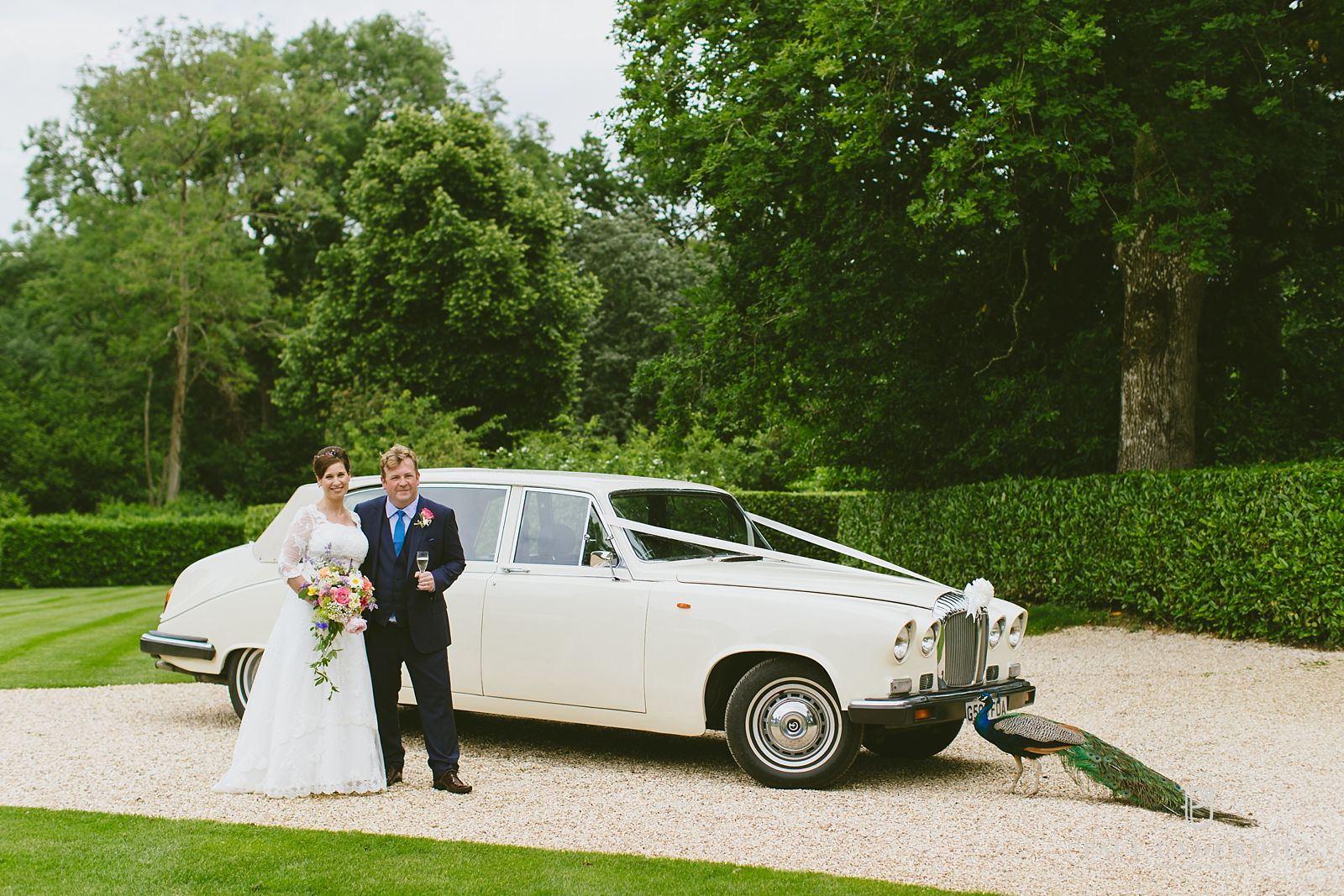 Wedding car bride and groom portrait