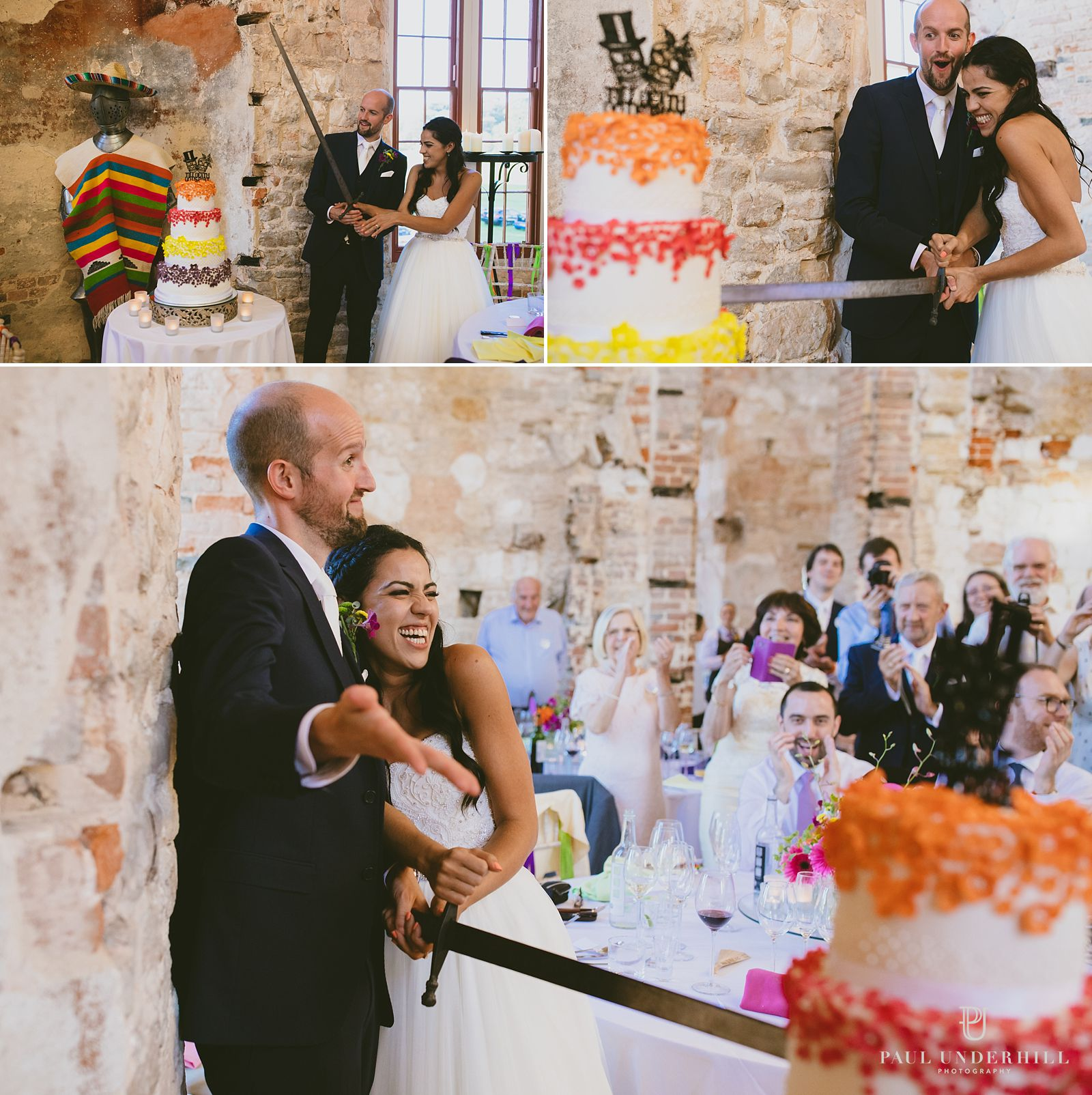 bride-and-groom-cut-the-cake-lulworth