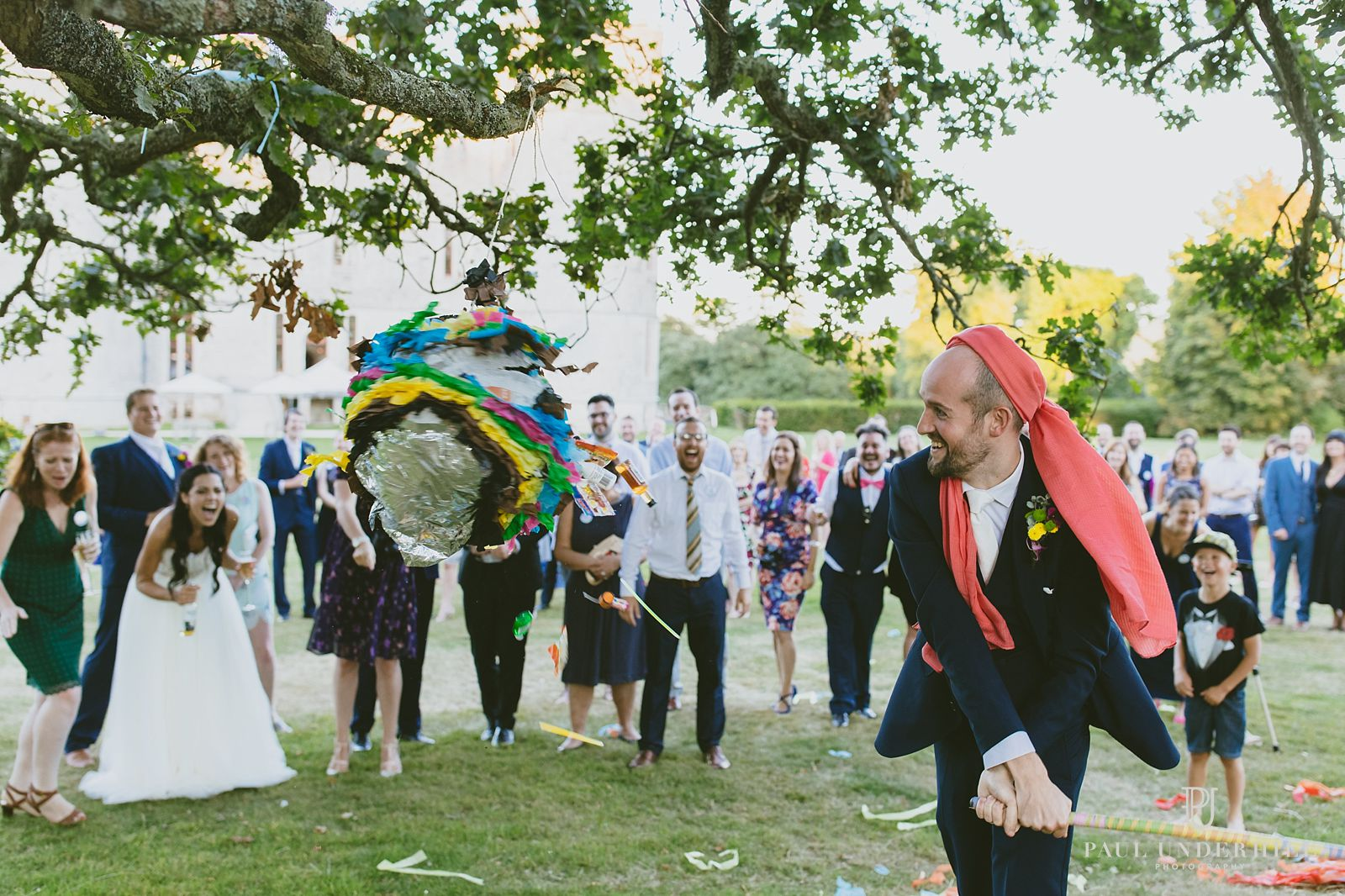 groom-bashes-pinata-lulworth-castle