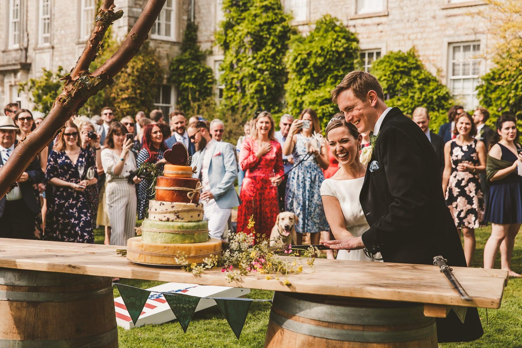 Cutting cake Smedmore House wedding photography