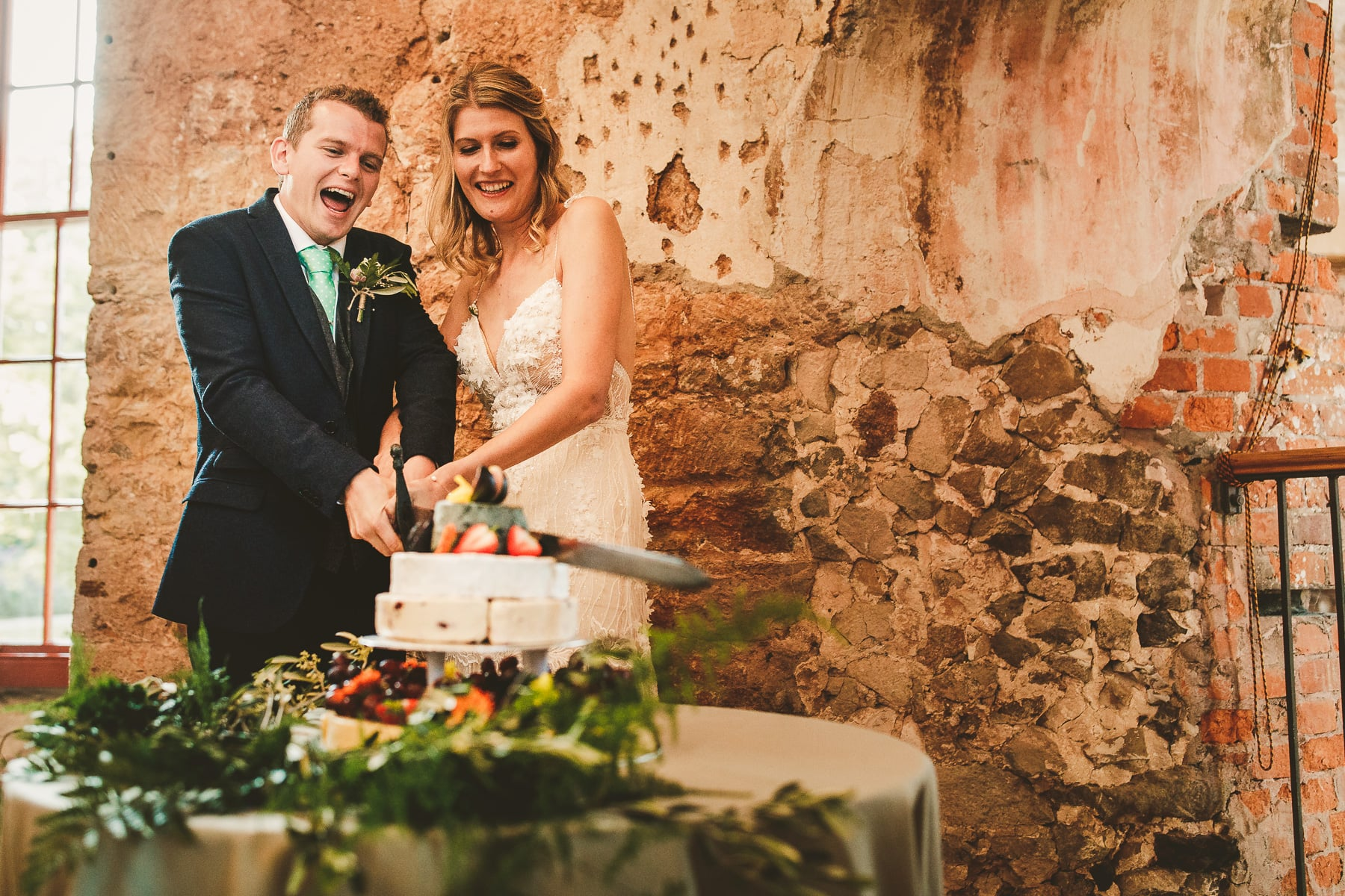 Wedding-cake-cutting-Lulworth-Castle-Dorset