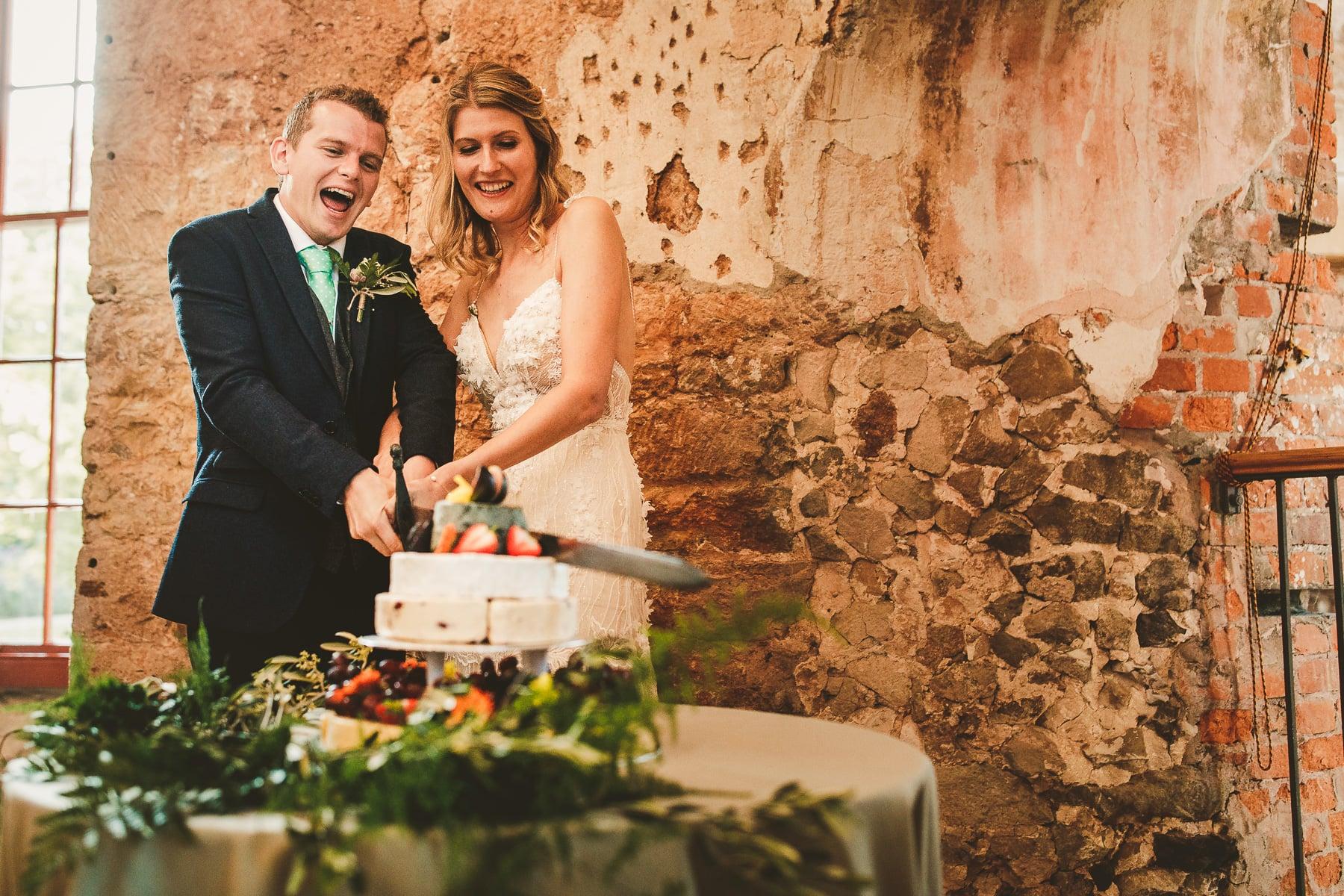Wedding-cake-cutting-Lulworth-Castle-Dorset